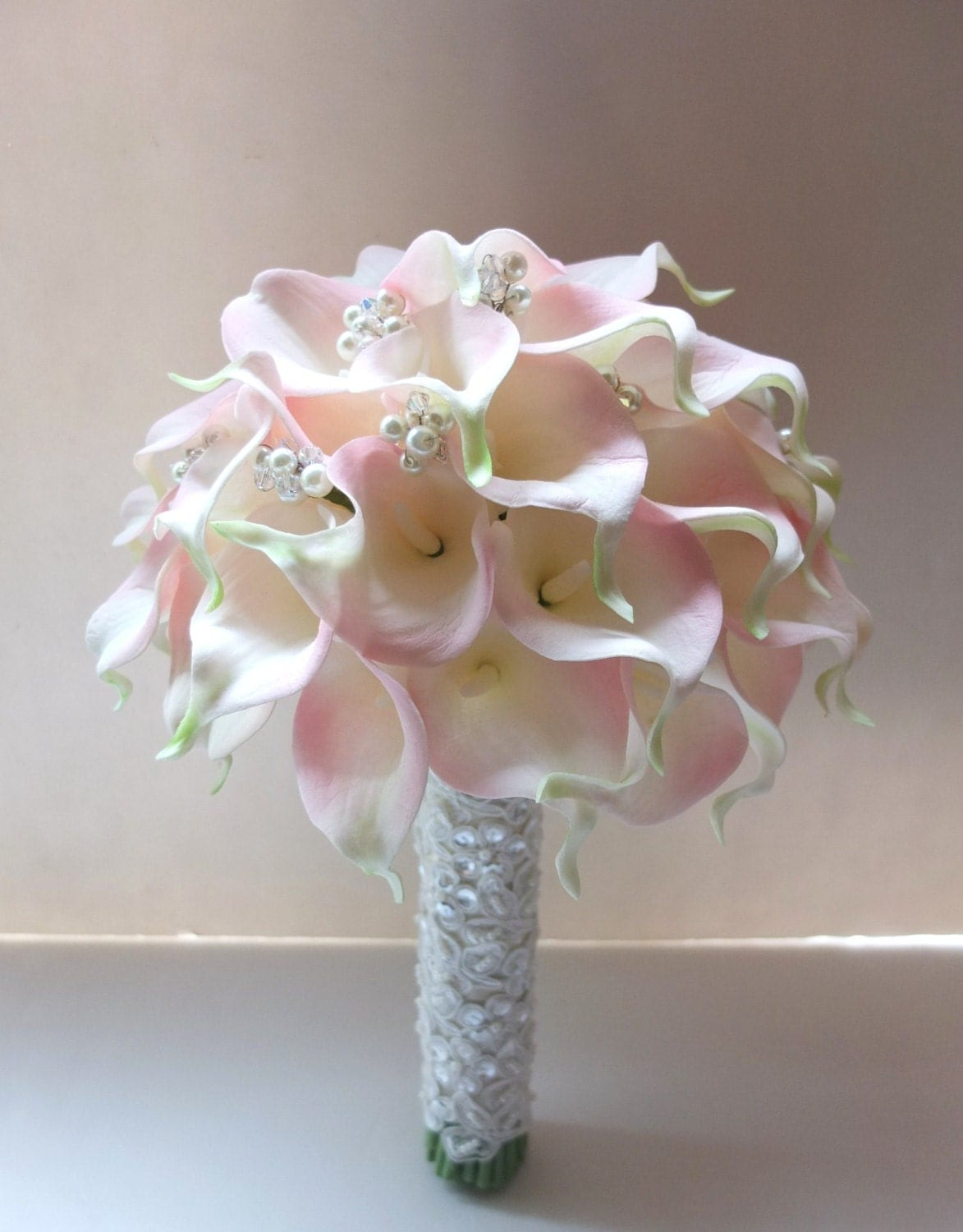 Blush pink calla lily bouquet accented with pearls