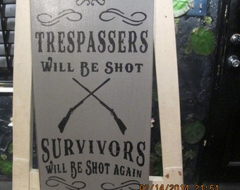 Painted Trespassers Sign on Wood Board