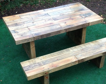 reclaimed wood table with one bench