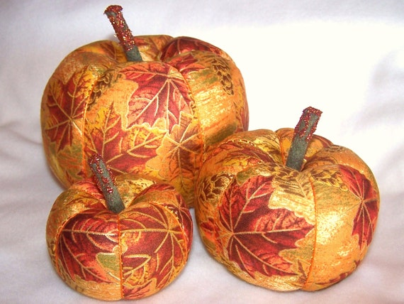 A Set of Three Fabric Pumpkins for the Autumn One Bright Orange Pumpkin One Gold on Gold Pumpkin One Large Brown with Berries Pumpkin