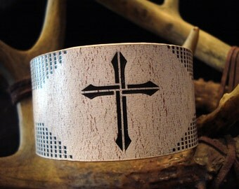 White and black distressed leather cuff bracelet with cross.