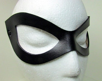 Harley Quinn Mask, superhero in shiny or flat  black leather , rounded nose, less angles cat woman, super hero , ms marvel BIG eyes