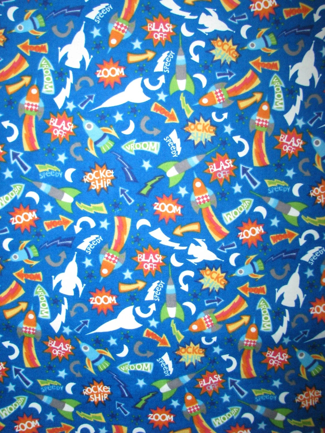 Glow in the dark space flannel fabric rockets by fabricfrantic for Space fabric by the yard