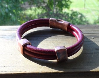 Men's thick leather bracelet in dark burgandy leather and Tierra cast copper slides and magnetic closure