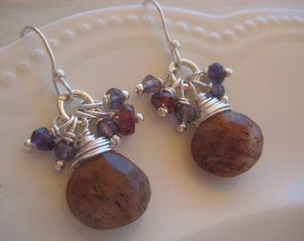 Earrings made with rutilated quartz, iolite, ruby and amethyst beads