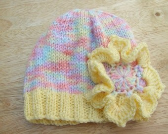 Hand knitted baby beanie hat yellow and pastels with flower applique 0-3 months - knitted baby clothes