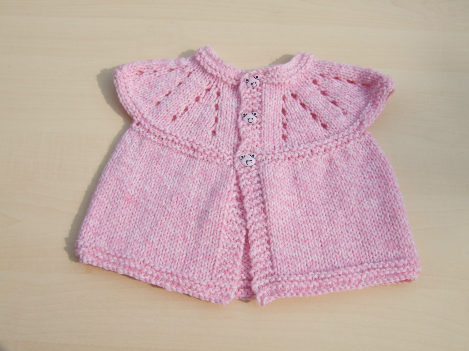 Baby sleeveless cardigan hand knitted in pink and cream mix