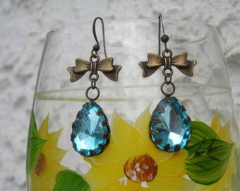 SKY blue tear drop fleur de LYS brass setting & bow earrings.