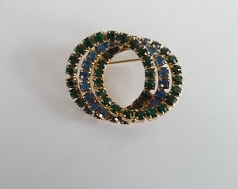 Vintage Green And Blue Glass Rhinestone Infinity Brooch.....no 410