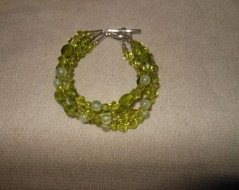 "Bracelet By ""Iki""  Four Strand Shades Of Green Glass Bracelet"