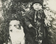 Little boy posing with dog and bunny toy antique photo