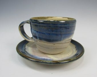 White and blue mug and plate. Cup and saucer