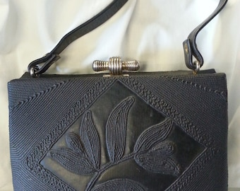 Faux corde plastic purse with gold tone frame