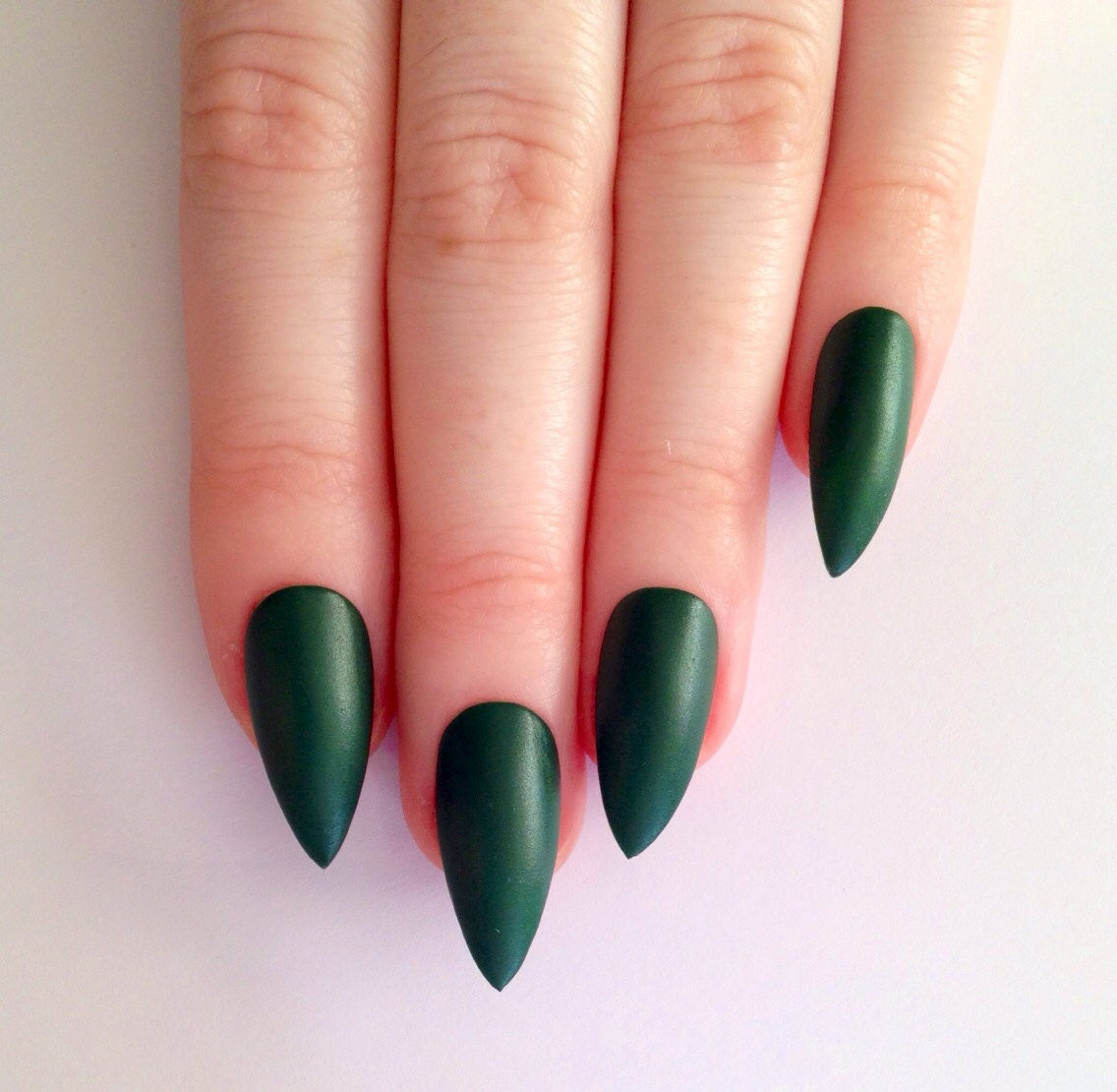 Mint green stiletto nails