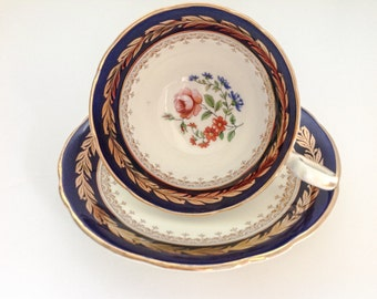 Gorgeous Aynsley tea cup and saucer in rich cobalt blue and white.
