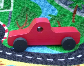 Handmade, eco-friendly, wooden toy pick-up truck, red paint