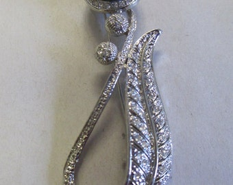 Vintage brooch silver toned with tiny crystal insets no markings