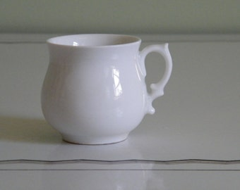 Vintage White Porcelain Cup with Handle  Stamped with Cross on bottom