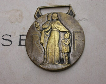 A beautiful french antique medal  heavy  bronze  minister  medal crown  child woman olive leaves coat of arms  fireman joan of arc pendant