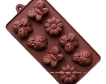 8 Cavity Butterfly Ladybug Bee Flower Silicone Bakeware