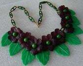 Vintage early plastic celluloid lucite violets and leaves necklace  Unique vintage, antique, costume and estate jewelry.