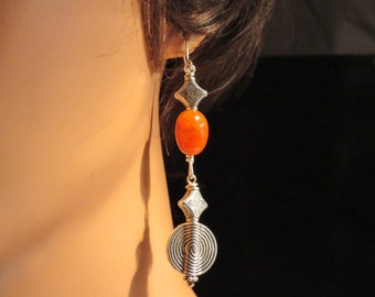 Earrings made of Carnelian semi prescious gemstones, pewter findings and sterling silver ear wires