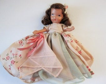 A 'Nancy Ann' Story Book Doll - Bisque, Mid 40s Doll - Flowered Dress and Hanky Attached With a Pink Ribbon - Doll Collector