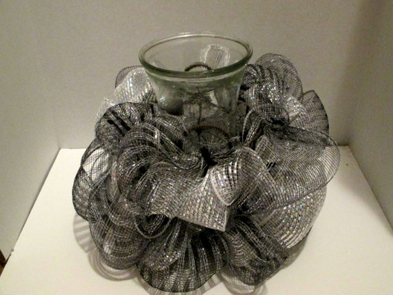 Items similar to centerpiece made with black and silver