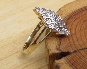 A vintage 9K yellow gold diamond ring