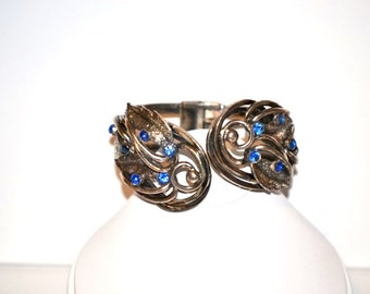 Vintage Signed Tortolani Clamper Bracelet with Blue Rhinestones