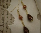 Earrings.Pierced.Dangle.Recrafted vintage beads.Burgundy and goldtone