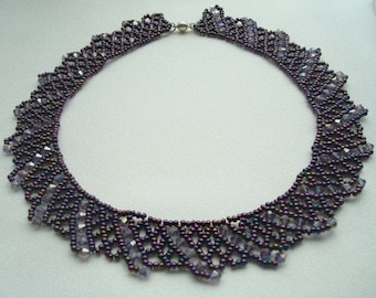 Dark purple necklace of beads and Swarovski crystals