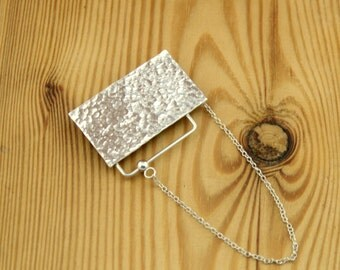 Sterling silver hammered texture brooch with chain and kinetic sliding ball