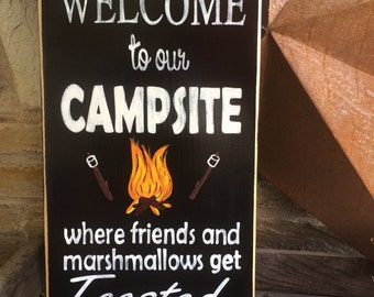 Welcome to our Campsite where friends and marshmallows get toasted at the same time! Wooden sign