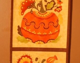 Four panel Fall wall hanging with decorated pumpkins in beautiful oranges and golds