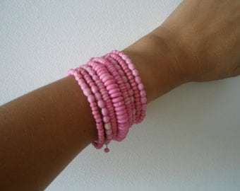 Multi rows bracelet. Made of wood on metal ring