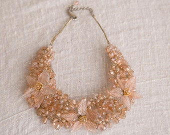 Fun and flirty pink floral beaded wire necklace
