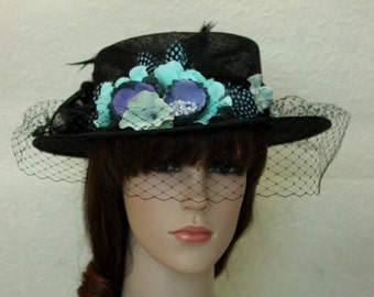 A Black Flower Sinamay Church Bowler Derby Hat with Flowers,Net And Feather.