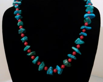 Handmade & knotted Turquoise, Red Coral, and Silver tone Necklace.