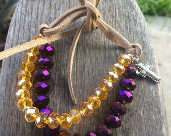 Handmade Beaded Bracelet w LSU Colors. Crystal Beads with silver cross and tan suede tie.