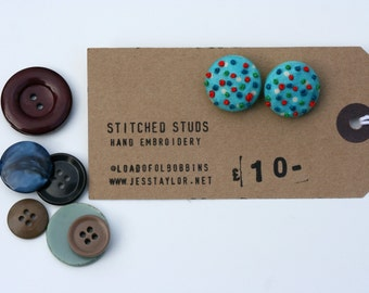 Stitched Studs - Round blue and white polka dot hand embroidered fabric stud earrings.