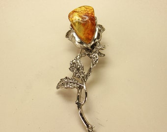 Chrome brooch with natural Baltic amber