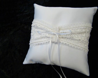 Dainty white satin ring bearer pillow with lace and pearl trim