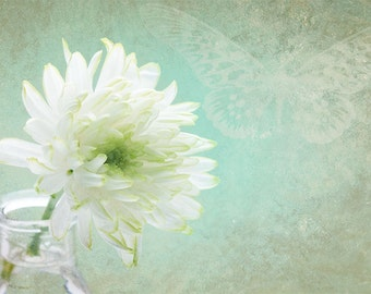 White flower wall art with delicate hints of green