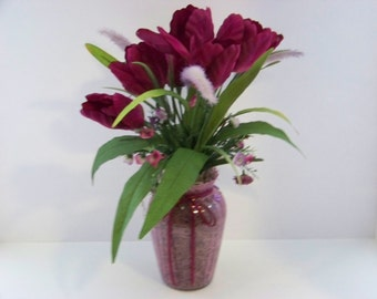 Artificial silk flower arrangement centerpiece for springtime use