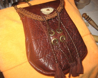 Handcrafted leather sporran, laced and hand tooled.