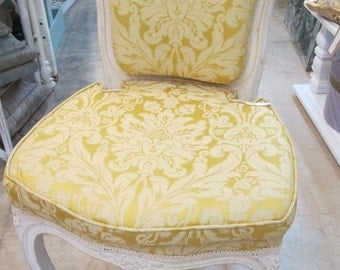 Wonderful timeless vintage wood chair covered in a Fortuny Style fabric of soft yellows and cream.