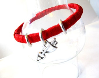Red Hand Wrapped Bangle With Ribbon And Added Charm