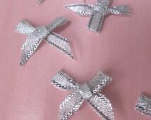 100 Bows -  silver mini bows - small bows silver - miniature craft bows - silver bows - silver christmas bows