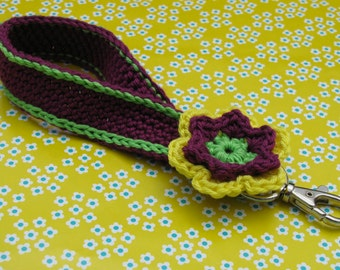 Purple Keychain with hook and flower.
